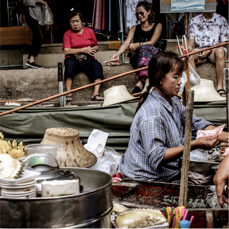 A Woman Selling Items at a Thai Market