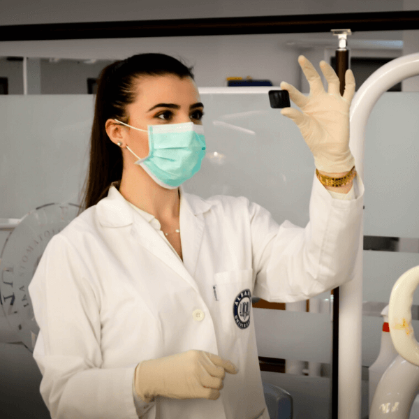 A female scientist looking at a microscope slide in a lab.