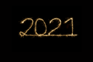 """The text """"2021""""spelled out in fireworks against a black background."""