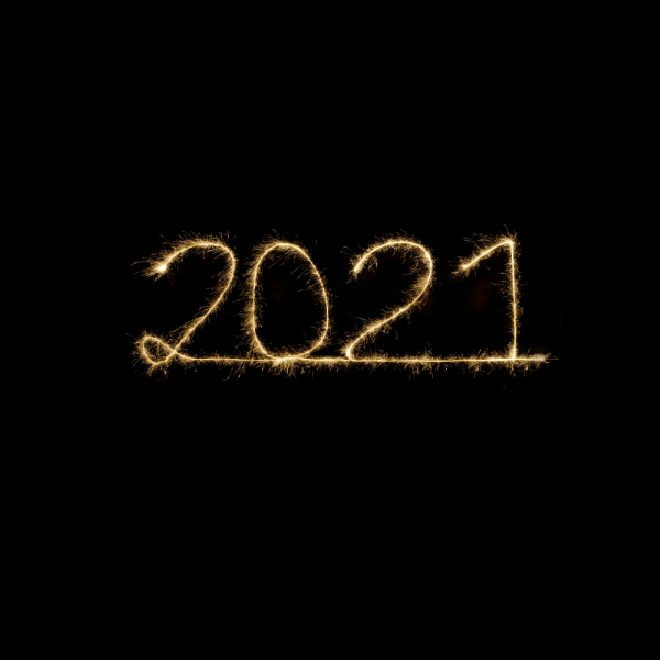 "The text ""2021""spelled out in fireworks against a black background."