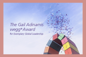 "The text ""The Gail Adinamis wegg® Award for exemplary global leadership"" is written across a blue sky background with multi-colored confetti around it."