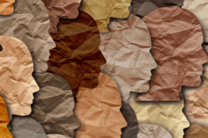 19 side profiles of human faces are overlapping each other. They are cut out of different colored paper.